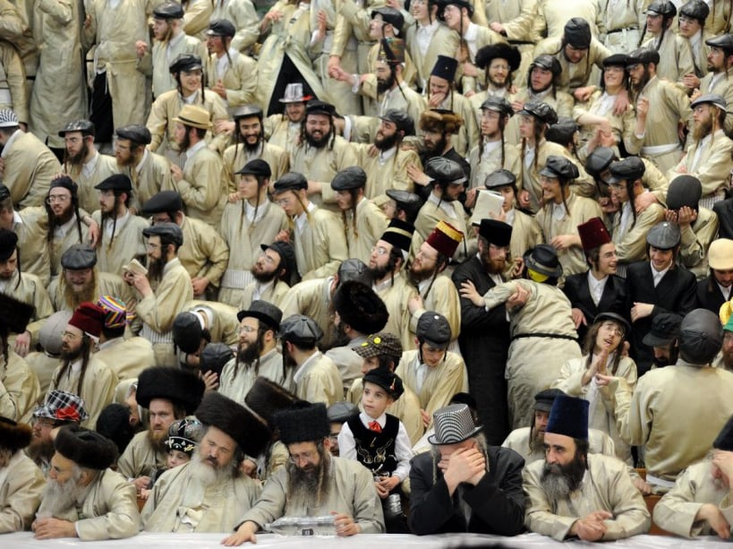 Ultra-Orthodox Jews celebrate the Purim holiday in the ultra-orthodox Mea Shearim neighborhood in Jerusalem